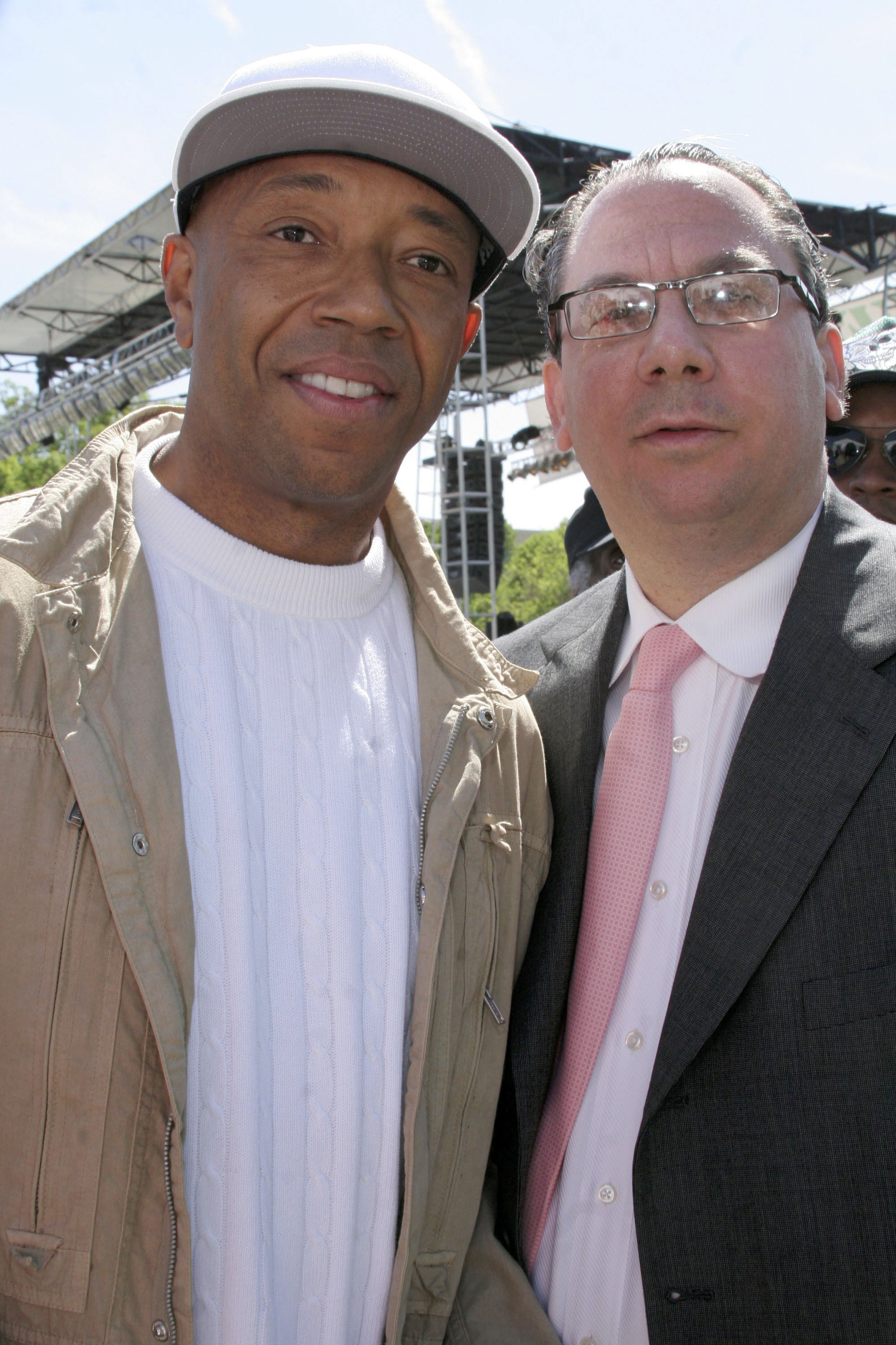 """WASHINGTON - APRIL 30: Russell Simmons (L) and Rabbi Marc Schneier (R) arrive at """"Save Darfur: Rally To Stop Genocide"""" April 30, 2006 in Washington, DC. (Photo by Nancy Ostertag/Getty Images)"""