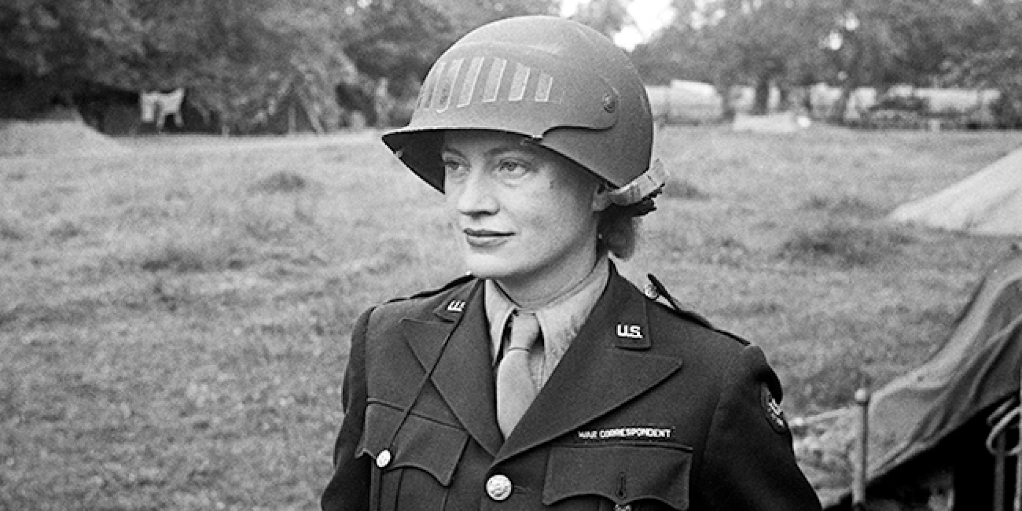Lee Miller in steel helmet specially designed for using a camera, Normandy, Unknown Photographer, 1944